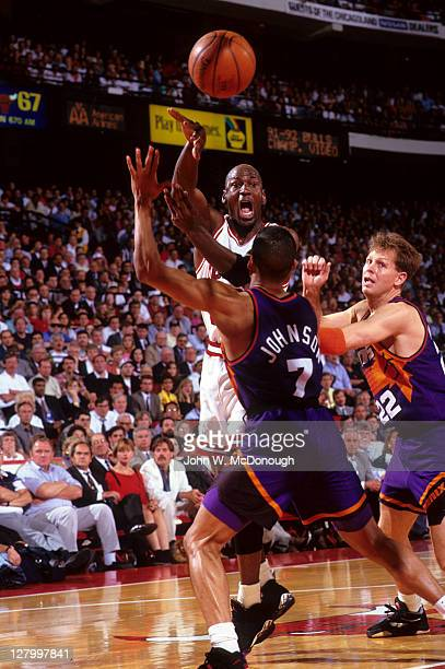 NBA Finals Chicago Bulls Michael Jordan in action passing vs Phoenix Suns Danny Ainge and Kevin Johnson at Chicago Stadium Game 4 Chicago IL CREDIT...