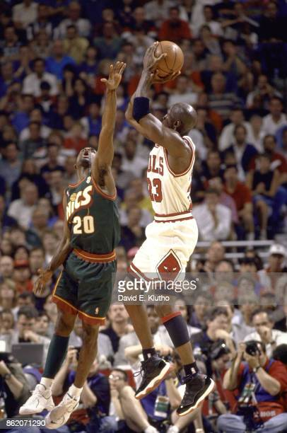 NBA Finals Chicago Bulls Michael Jordan in action shooting vs Seattle SuperSonics Gary Payton at United Center Game 6 Chicago IL CREDIT David E Klutho