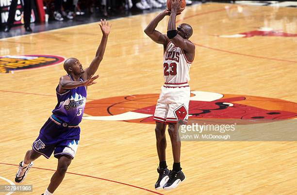 NBA Finals Chicago Bulls Michael Jordan in action shot vs Utah Jazz Bryon Russell at United Center Game 1 Jordan with game winning shot Chicago IL...