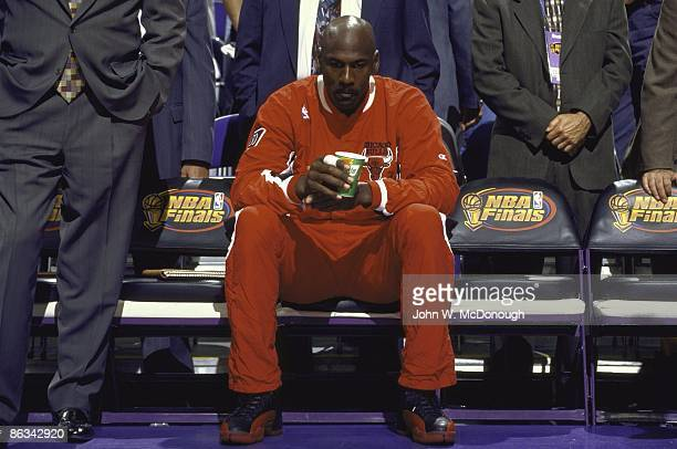 NBA Finals Chicago Bulls Michael Jordan on sidelines bench before Game 5 vs Utah Jazz Jordan had a stomach virus that caused a fever and dehydration...