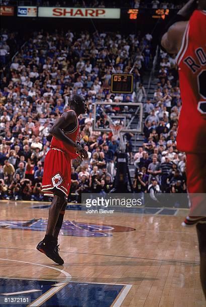 Basketball NBA Finals Chicago Bulls Michael Jordan victorious after making game winning shot during Game 6 vs Utah Jazz Salt Lake City UT 6/14/1998