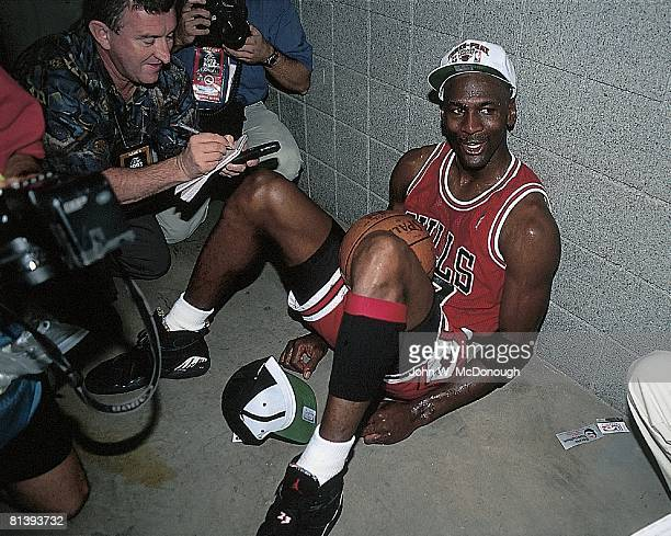 Basketball NBA Finals Chicago Bulls Michael Jordan victorious outside locker room after winning Game 6 and championship vs Phoenix Suns View of media...
