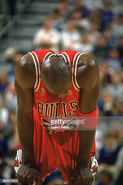NBA Finals Chicago Bulls Michael Jordan with head down on court during Game 5 vs Utah Jazz Jordan had a stomach virus that caused a fever and...