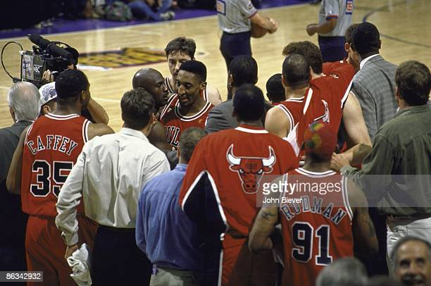 NBA Finals Chicago Bulls Scottie Pippen helping teammate Michael Jordan walk off court during Game 5 vs Utah Jazz Jordan had a stomach virus that...