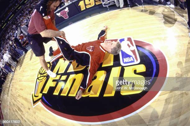 NBA Finals Chicago Bulls Steve Kerr stretching with trainer before game vs Seattle SuperSonics at KeyArena Game 4 Kerr stretching on top of NBA...