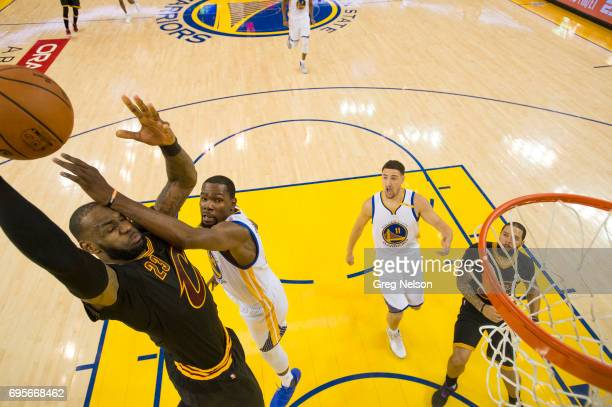 NBA Finals Cleveland Cavaliers LeBron James in action dunk vs Golden State Warriors Kevin Durant at Oracle Arena Game 5 Oakland CA CREDIT Greg Nelson