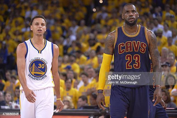 NBA Finals Cleveland Cavaliers LeBron James with Golden State Warriors Stephen Curry during game at Oracle Arena Game 1 Oakland CA CREDIT John W...