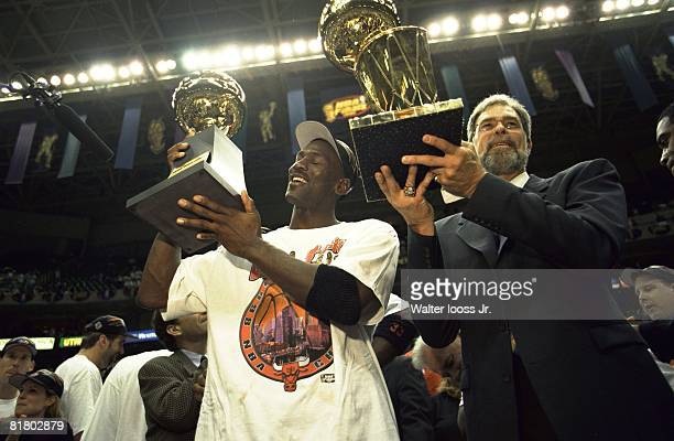 Basketball NBA Finals Closeup of Chicago Bulls Michael Jordan and coach Phil Jackson victorious with sixth NBA Championship trophy after winning Game...