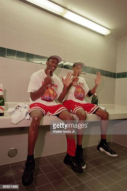 NBA Finals Closeup of Chicago Bulls Michael Jordan and Scottie Pippen victorious smoking cigar in locker room after winning Game 6 and championship...