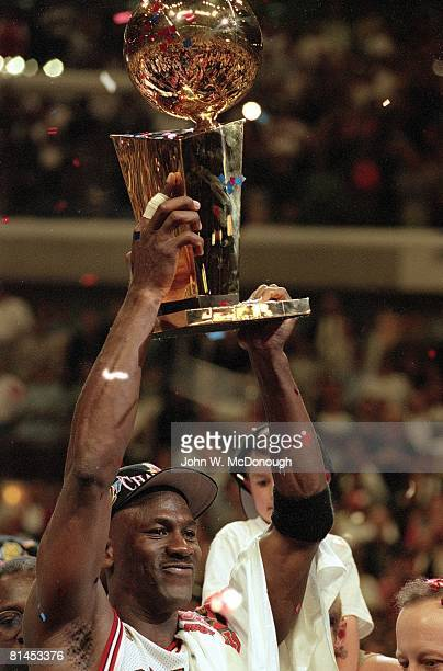 Basketball NBA Finals Closeup of Chicago Bulls Michael Jordan victorious with NBA Championship trophy after winning Game 6 vs Utah Jazz Chicago IL...