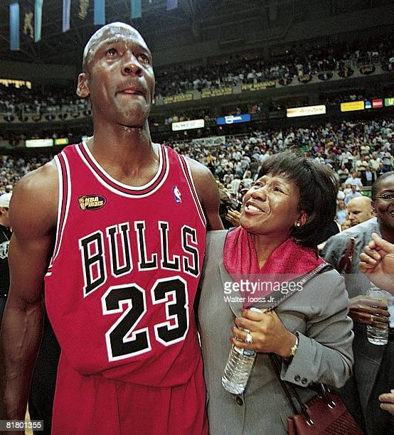 Basketball NBA finals Closeup of Chicago Bulls Michael Jordan victorious with mother Deloris after winning game vs Utah Jazz Salt Lake City UT...