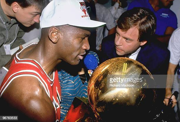 Finals: Closeup of Chicago Bulls Michael Jordan victorious with Larry O'Brien trophy after winning Game 5 and series vs Los Angeles Lakers. View of...