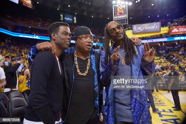 NBA Finals Comedian Chris Rock rappers E40 and Snoop Dogg courtside before Golden State Warriors vs Cleveland Cavaliers game at Oracle Arena Game 5...