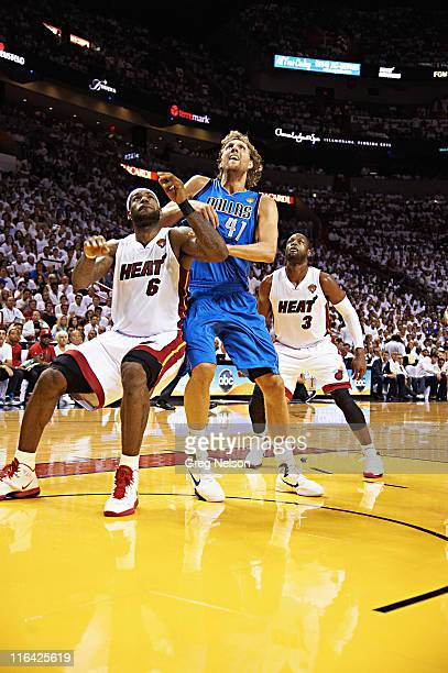 NBA Finals Dallas Mavericks Dirk Nowitzki in action boxing out vs Miami Heat LeBron James and Dwyane Wade at American Airlines Arena Game 6 Cover...