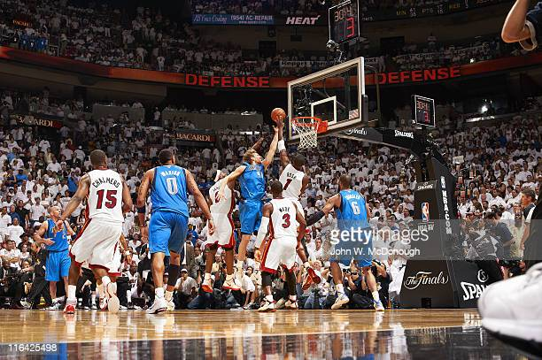 NBA Finals Dallas Mavericks Dirk Nowitzki in action scoring his final points of the game vs Miami Heat LeBron James Chris Bosh and Dwyane Wade at...