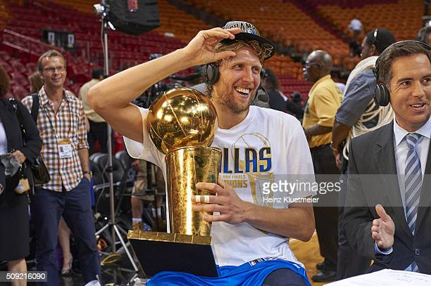 NBA Finals Dallas Mavericks Dirk Nowitzki victorious holding Larry O'Brien Championship trophy after winning Game 6 and series vs Miami Heat at...
