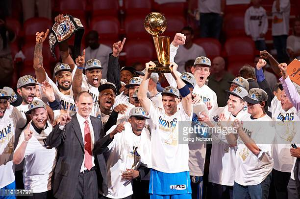 NBA Finals Dallas Mavericks Jason Kidd victorious holding Larry O'Brien Championship trophy with teammates after winning Game 6 and championship...