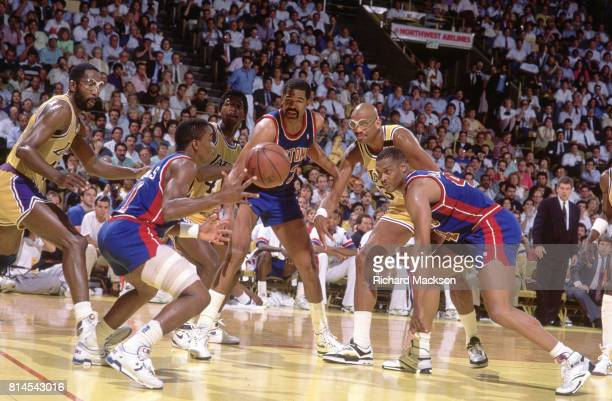 NBA Finals Detroit Pistons Isiah Thomas in action vs Los Angeles Lakers James Worthy AC Green and Kareem AbdulJabbar at The Forum Game 4 Detroit...