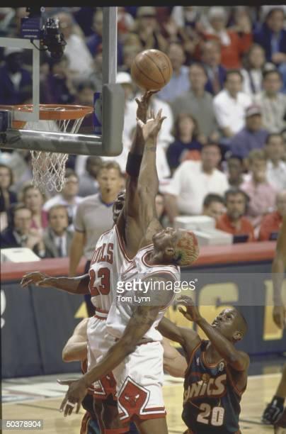 NBA Finals Game 6 Chicago Bulls Michael Jordan in action rebounding w teammate Dennis Rodman vs Seattle SuperSonics
