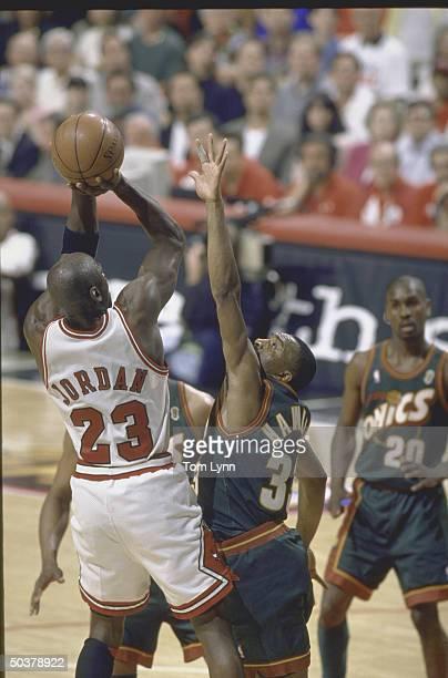 Finals Game 6. Rear view of Chicago Bulls Michael Jordan in action, shooting vs Seattle SuperSonics Hersey Hawkins.