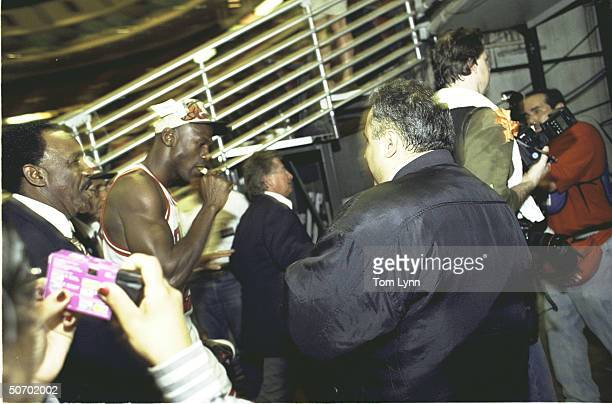 NBA Finals Game 6 View of Chicago Bulls Michael Jordan walking into tunnel victorious smoking cigar after winning game championship vs Seattle...