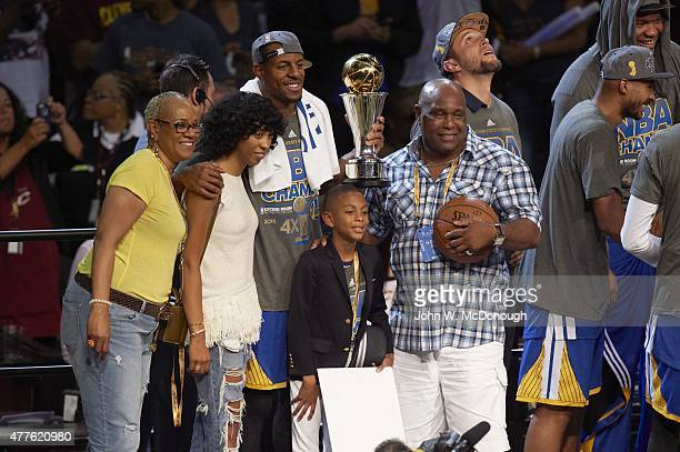 NBA Finals Golden State Warriors Andre Iguodala victorious holding Bill Russell NBA Finals MVP Trophy with family after winning Game 6 and...