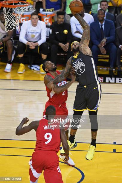 NBA Finals Golden State Warriors DeMarcus Cousins in action vs Toronto Raptors Kawhi Leonard at Oracle Arena Game 6 Oakland CA CREDIT John W McDonough