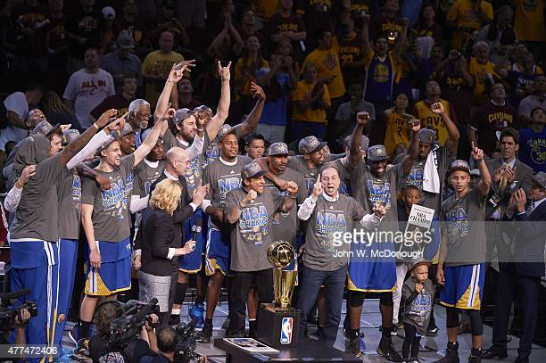 NBA Finals Golden State Warriors owner Joe Lacob victorious approaching the Larry O'Brien Trophy after winning Game 6 and championship series vs...