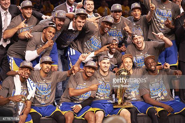 NBA Finals Golden State Warriors players victorious with Larry O'Brien Trophy after winning Game 6 and championship series vs Cleveland Cavaliers at...