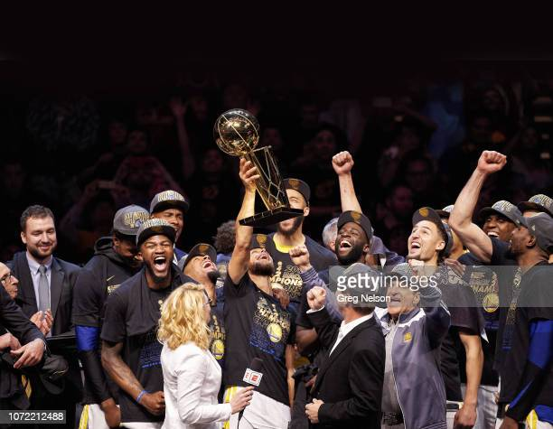 NBA Finals Golden State Warriors Stephen Curry victorious holdiing up Larry O'Brien NBA Championship Trophy after winning game and series vs...