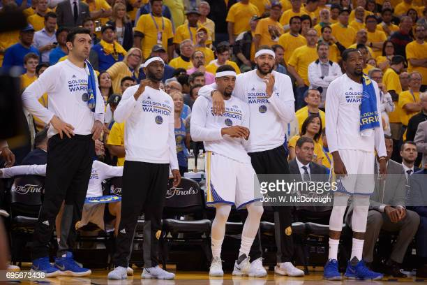 NBA Finals Golden State Warriors Zaza Pachulia Ian Clark James Michael McAdoo JaVale McGee and Kevin Durant on sidelines during game vs Cleveland...