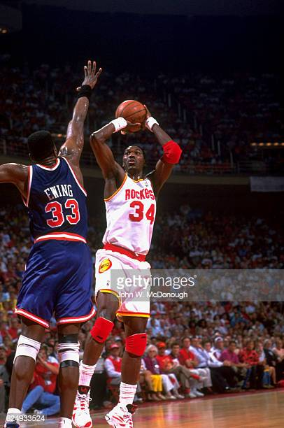 NBA Finals Houston Rockets Hakeem Olajuwon in action shooting vs New York Knicks Patrick Ewing at The Summit Game 7 Houston TX CREDIT John W McDonough