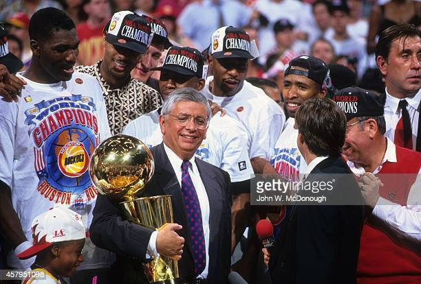 NBA Finals Houston Rockets Hakeem Olajuwon Kenny Smith and teammates victorious with Larry O'Brien Championship Trophy commissioner David Stern and...