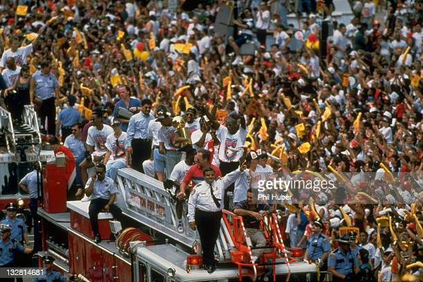 NBA Finals Houston Rockets players riding on fire truck with Larry O'Brien trophy during championship victory parade Houston TX CREDIT Phil Huber