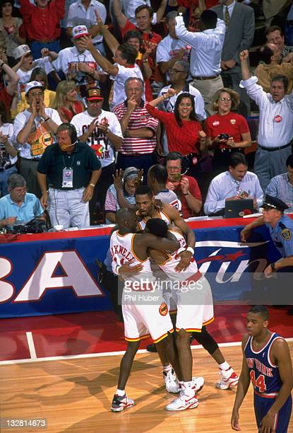 NBA Finals Houston Rockets Robert Horry Vernon Maxwell and Kenny Smith victorious on court after winning Game 7 and championship series vs New York...