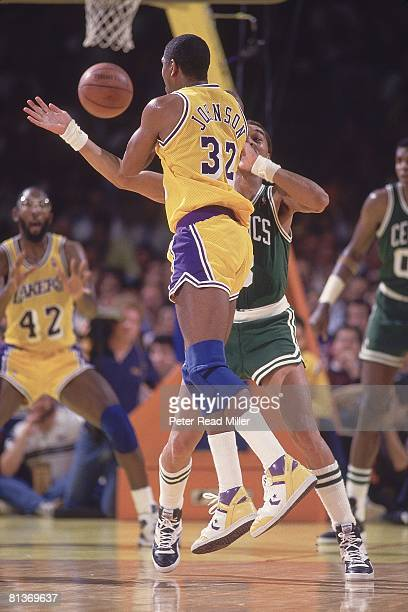 Basketball NBA Finals Los Angeles Lakers Earvin Magic Johnson and James Worthy in action vs Boston Celtics Dennis Johnson Inglewood CA...