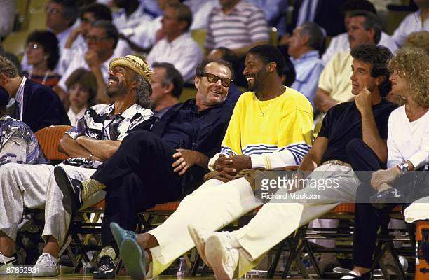 NBA Finals Los Angeles Lakers fan and celebrity actor Jack Nicholson with producer Lou Adler with former player Norm Nixon in stands during Game 2 vs...