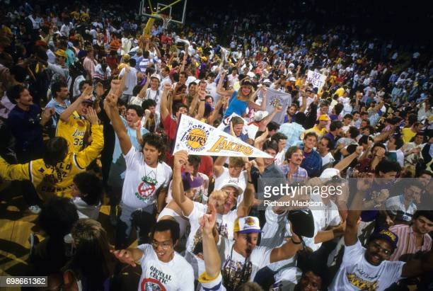 NBA Finals Los Angeles Lakers fans victorious on court after winning Game 6 and championship series vs Boston Celtics at The Forum Inglewood CA...