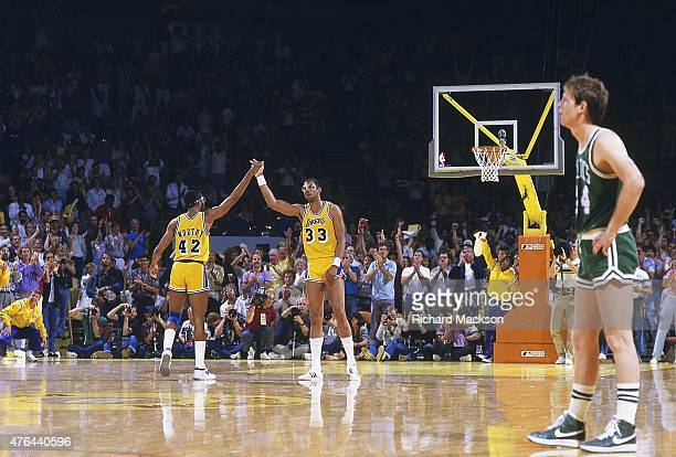 NBA Finals Los Angeles Lakers Kareem AbdulJabbar and James Worthy victorious high five on court during Game 3 vs Boston Celtics at The Forum...