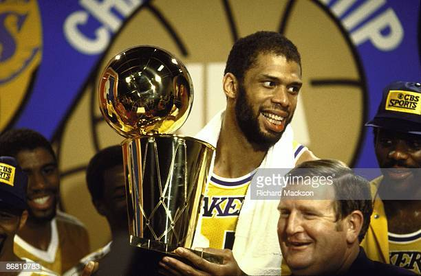 NBA Finals Los Angeles Lakers Kareem AbdulJabbar victorious with Walter A Brown championship trophy in locker room after winning Game 6 and series vs...