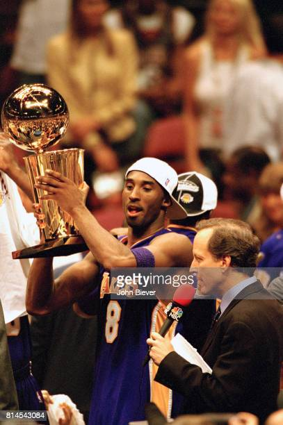 Los Angeles Lakers Kobe Bryant victorious holding up Larry O'Brien NBA Championship trophy after winning game and series vs holds New Jersey Nets at...
