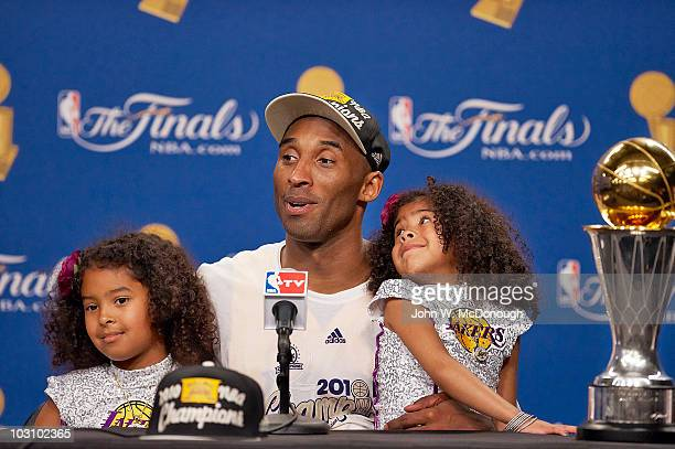 NBA Finals Los Angeles Lakers Kobe Bryant victorious with his daughters Gianna and Natalia and Larry O'Brien Trophy during press conference after...