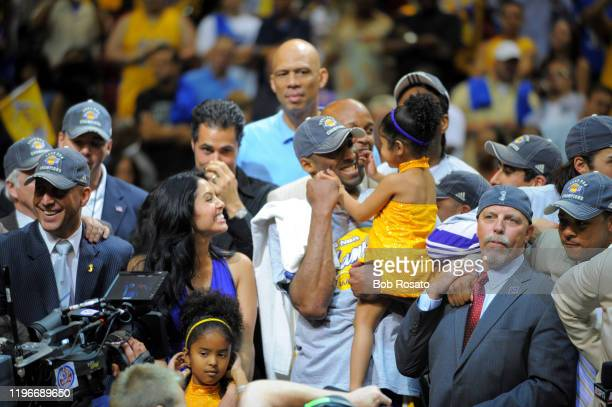 NBA Finals Los Angeles Lakers Kobe Bryant victorious with wife Vanessa and daughter Gianna after winning Game 5 and championship series vs Orlando...