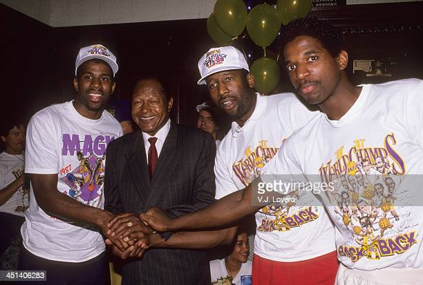 NBA Finals Los Angeles Lakers Magic Johnson James Worthy and AC Green victorious posing with Los Angeles mayor Tom Bradley in locker room after...