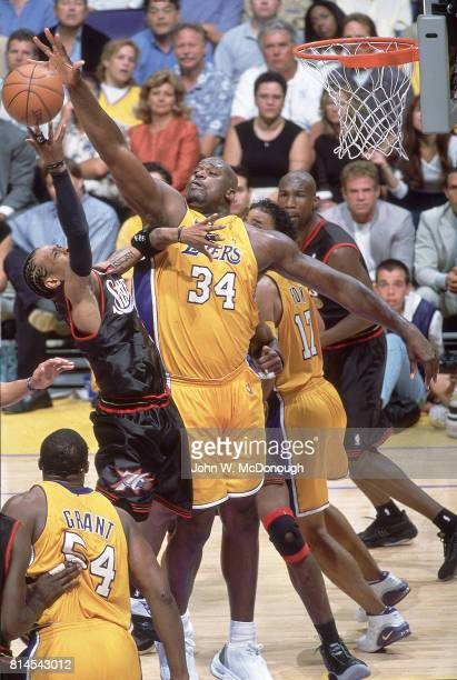 Finals: Los Angeles Lakers Shaquille O'Neal in action, defense vs Philadelphia 76ers Allen Iverson at Staples Center. Game 1. Los Angeles, CA...