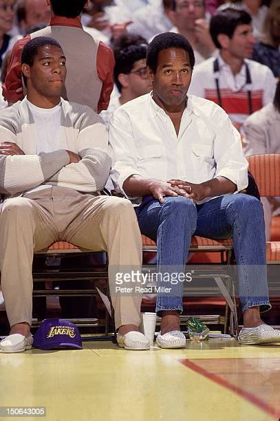 NBA Finals Los Angeles Raiders Marcus Allen and Hall of Famer OJ Simpson sitting courtside during Los Angeles Lakers vs Boston Celtics at The Forum...