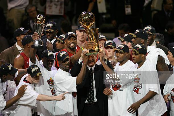 Basketball: NBA Finals, Miami Heat coach Pat Riley victorious with team and Larry O'Brien NBA Championship trophy after winning game and series vs...