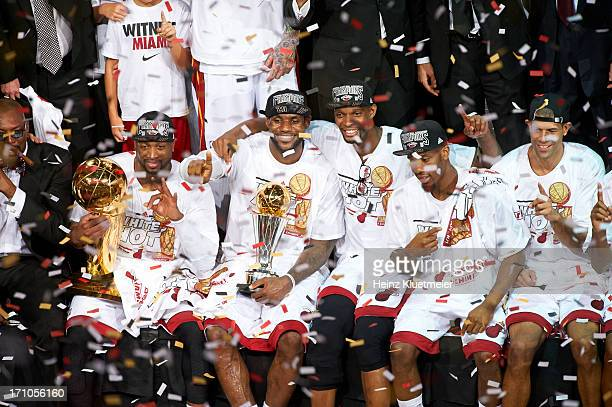 NBA Finals Miami Heat Dwyane Wade holding Larry O'Brien Championship Trophy LeBron James holding MVP Trophy Chris Bosh Norris Cole and Shane Battier...