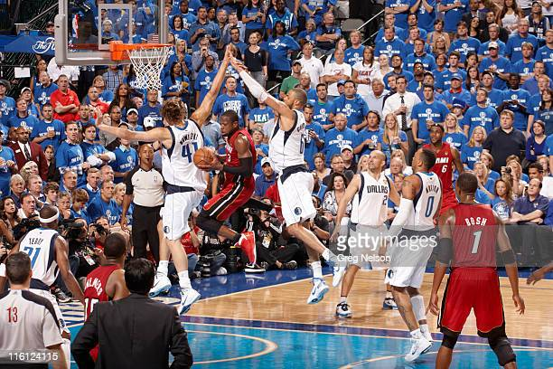 NBA Finals Miami Heat Dwyane Wade in action vs Dallas Mavericks Tyson Chandler and Dirk Nowitzki at American Airlines Center Game 4 Dallas TX CREDIT...