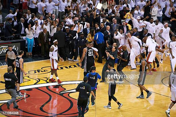 NBA Finals Miami Heat Dwyane Wade victorious hugging San Antonio Spurs Tim Duncan after winning Game 7 and series at American Airlines Arena Miami FL...